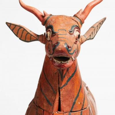 """""""It looks like it would really kick you, doesn't it?"""" says Genheimer of this Balinese drum carved to look like a goat with fang-like teeth. The drum was used in a traditional Indonesian gamelan orchestra."""