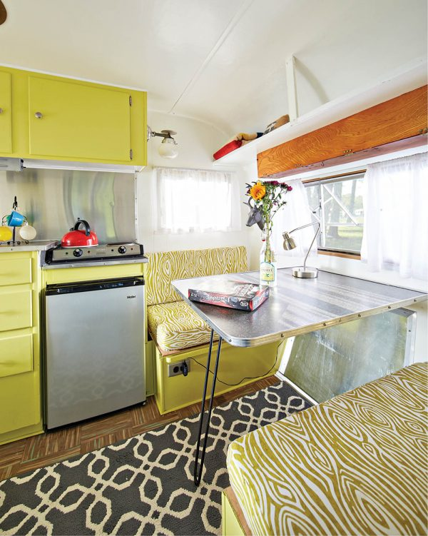 The Fan's kitchen is equipped with dishes, utensils, glassware, pots and pans, a two-burner stovetop, a new refrigerator and cabinets, plus baskets and cubbies for storage. From $70 per night, (513) 580-4660, routefiftycampers.com