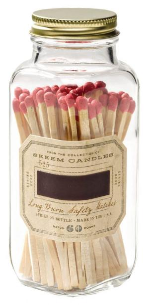 Match Point–A strike–on apothecary bottle keeps colorfully tipped matches safe from water splashes (and is clearly the classiest way to light a fire). Skeem red antique bottled matches, $14, MiCA 12/v, shopmica.com