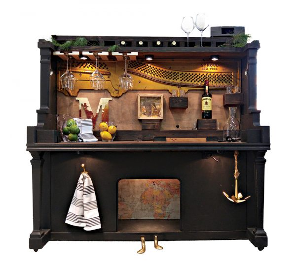 This playful take on a piano bar gave an antique instrument new life. Giant brandy snifter full of tips not included.