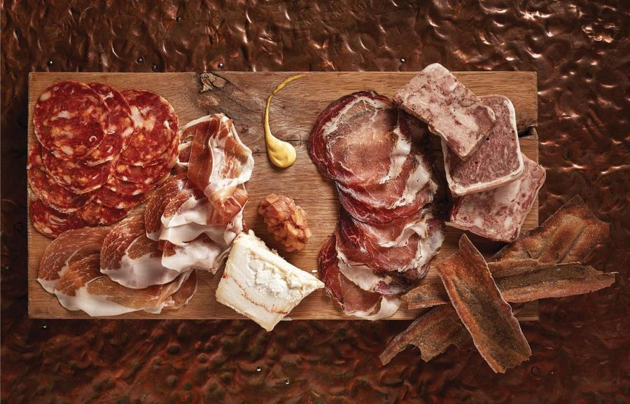 Clockwise from top left: New York purveyor Salumeria Biellese provides the soppressata picante; a schmear of Dijon mustard; Salumeria Biellese's coppa; three goodies from the Dutch's kitchen: spring rabbit terrine, pork and pork liver terrine with green peppercorn and truffle, and head cheese; housemade buckwheat crackers; ramp and green apple jam; Capriole Piper's Pyramide, a creamy, dense goat cheese from Greenville, Indiana; prosciutto Americano from Iowa-based La Quercia