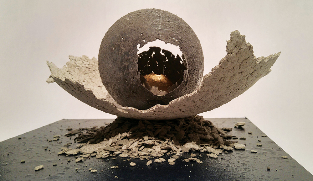 """PJ Grimm (b. 1983), Egg Formation 1 Campbell County Recorder series """"Golden Age"""", 2016, paper pulp (made from the Campbell County Recorder), cement, acrylic & gold leaf on wooden base"""