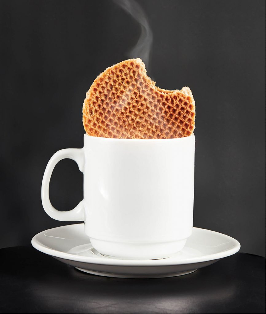 A stroopwafel—caramel syrup between two wafers—and coffee from Lisse.