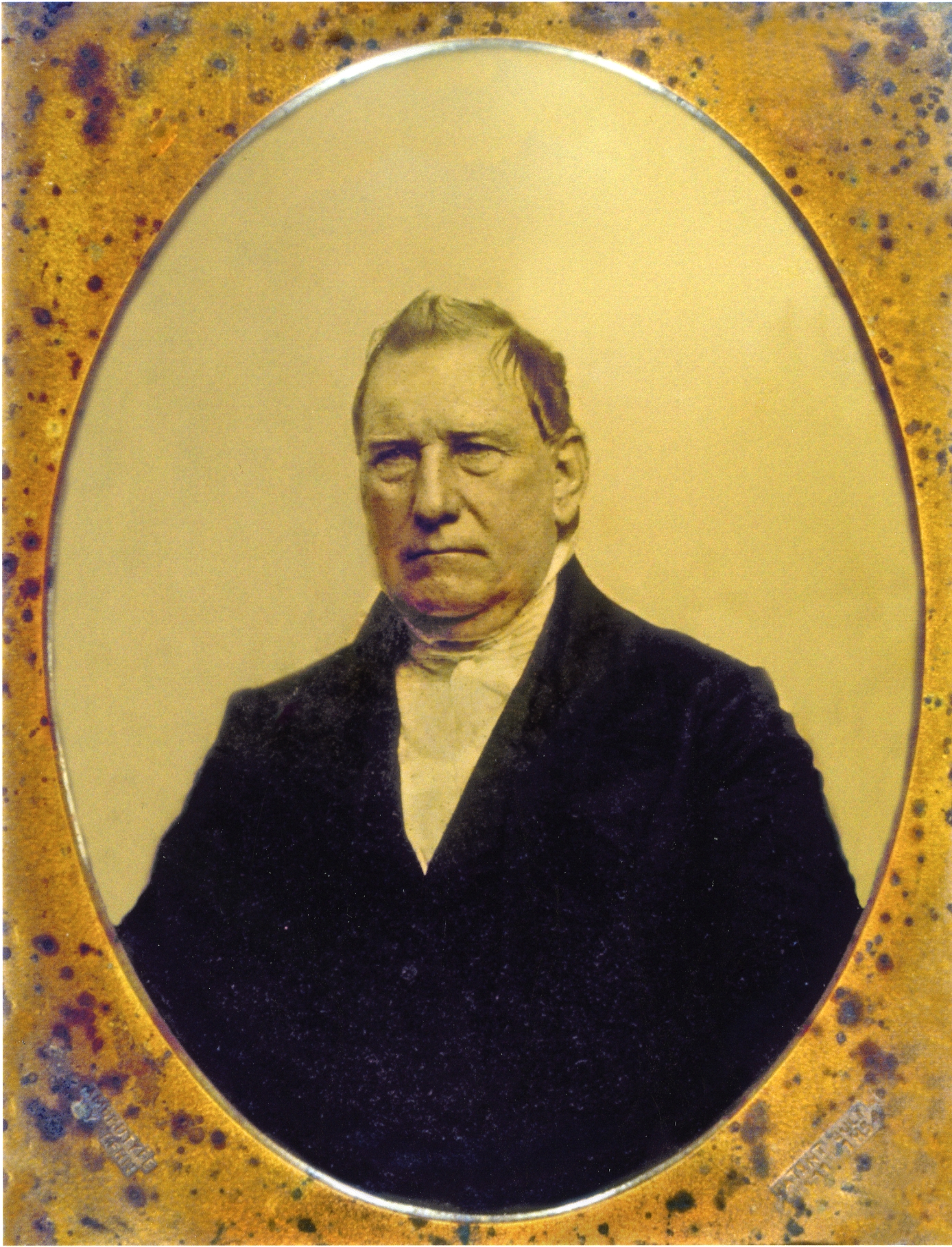 Picture of Charles McMicken: An older man with a white collared shirt on and a black blazer with a creme background.