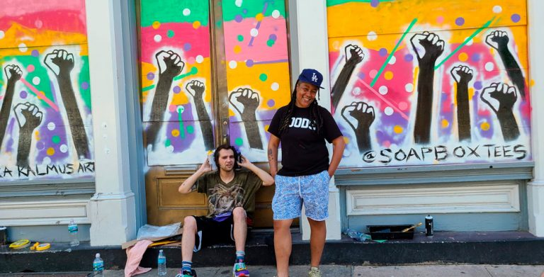Meet One of the Artists Behind the Powerful GOODS Storefront Mural